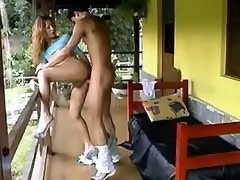 Guy has fun with sexy brunette tranny on porch
