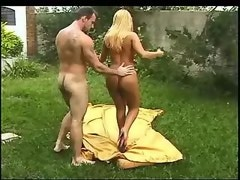 Hot guy and skinny blond trannie have fun outdoors