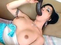 Sexy brunette tranny plays with big black dildo