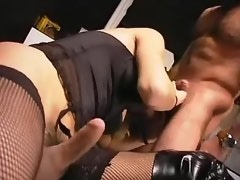 Tranny in black lingerie sucks cock