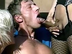 Guy sucks trannys dick while girl jerks him off