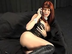 Vamp shemale in high boots sucking