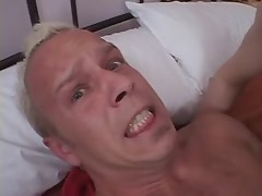 Lusty shemale in red fucked by depraved guy on bed
