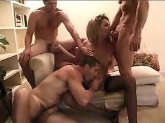 Cockloving blond tranny in black stockings in orgy