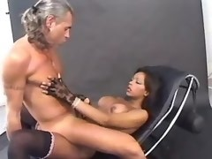 Beautiful black tranny fucks depraved man on chair
