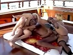 Two shemales fuck with girl and black hunk on deck