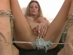 Lustful blond shemale playing with funny dildo