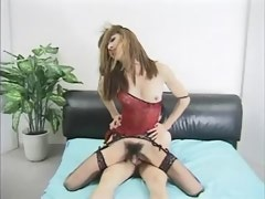 Erotic asian tranny takes sausage in ass on bed