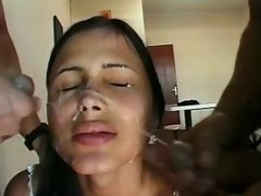 Cute latin shemale gets double facial cumshot
