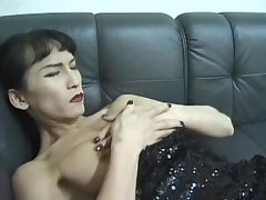 Asian shemale plays with fat dildo